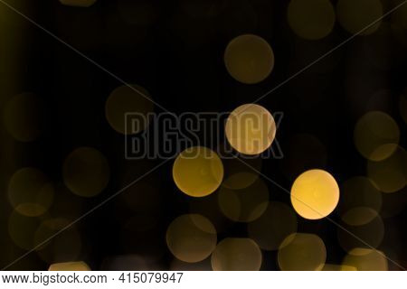 Christmas Abstract Defocused Glowing Light Dark Backdrop. High Quality And Resolution Beautiful Phot