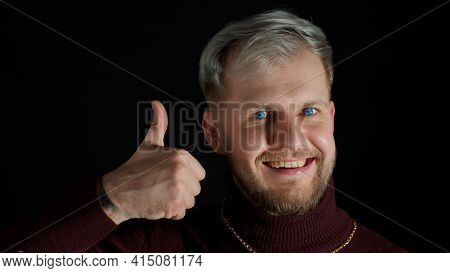 Cheerful Smiling Man In Stylish Blouse Looking Approvingly At Camera, Nods His Head, Showing Thumbs