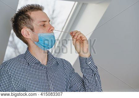 Home Test Kit, Swab With Test In Nose, Covid-19 Quick Self Test For Home, Young Man Performs Corona