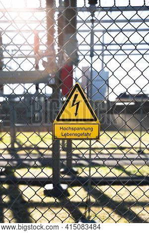 Warning Sign - Hochspannung Lebensgefahr, Translated: High Voltage Danger Of Life. Yellow Warning Si