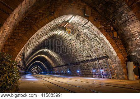 Illuminated Tramway Tunnel At Night In Bratislava, Slovakia