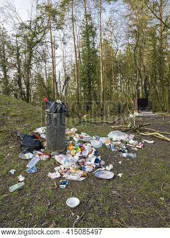 Watt, Switzerland - March 2, 2021: Pollution Of Nature - Dumped Piles Of Rubbish And Packaging Along