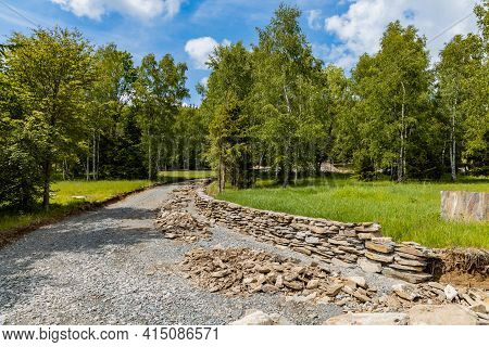 Small Stony Path With High Trees And Small Glade In Rudawy Janowickie