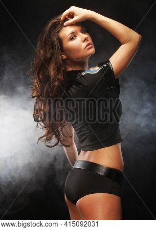 Fashion Shoot Of Young Sexy Striptease Dancer. Police Style.