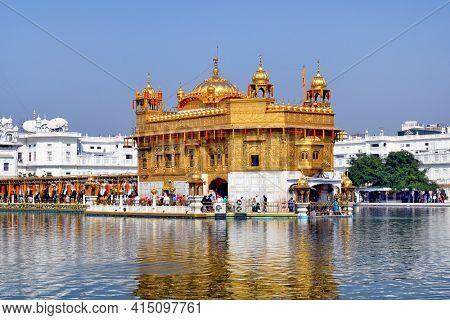 AMRITSAR, INDIA - 30 OCTOBER 2015: Golden Temple (Harmandir Sahib) in Amritsar, Punjab, India, the holiest Sikh gurdwara in the world.