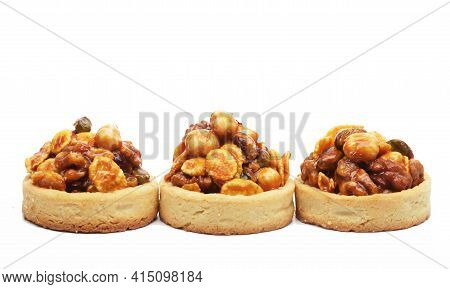 A Luscious Nutty Dessert Isolated On White.