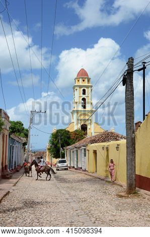 TRINIDAD, CUBA - JULY 25, 2016: Saint Francis of Assisi Church. The tower is located in the town Main Plaza and houses the Museum of the Fight against Bandits.