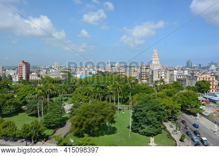 HAVANA, CUBA - JULY 24, 2016: Havana City seen from the Iberostar Parque Central Hotel. in the foreground is Parque Central looking towards Gran Teatro.