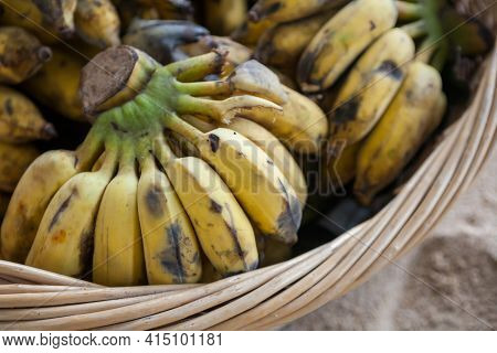 Close Up Of Bunch Of Banana In A Rattan Cage.