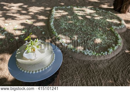 Wedding Cake With Flowers On Top In Thailand