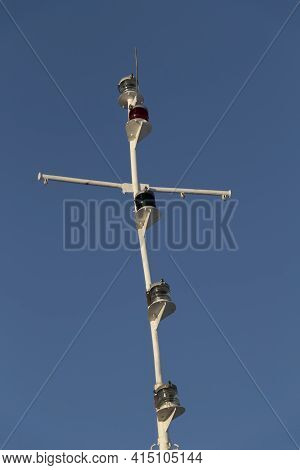 The Mast Of A Modern Ship Against The Background Of The Blue Sky.