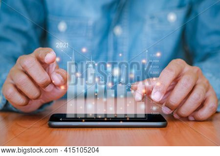 Businessman Use The Smartphone To Plans Business Growth In 2021. Concepts Of Finance, Marketing, Sal