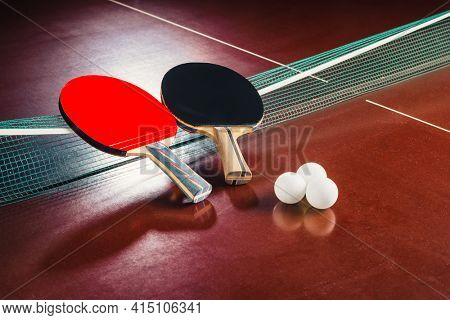 table tennis rackets on the net and balls