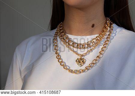 Beautiful Model Brunette In Modern Gold Metal Necklace Chain