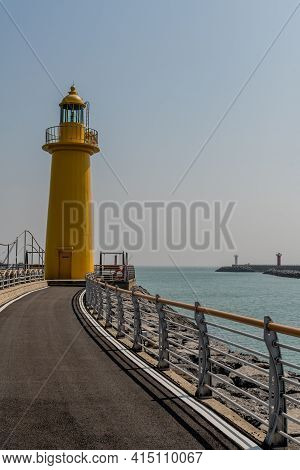 Yellow Lighthouse On End Of Pier