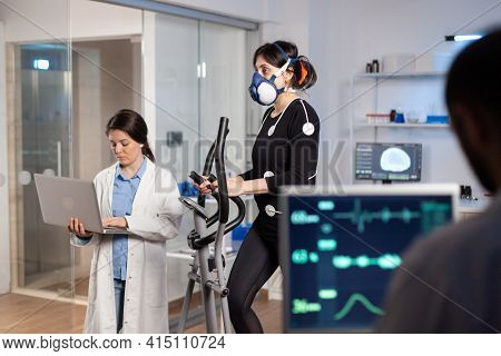 Team Of Medial Researchers Monitoring Vo2 Of Woman Performance