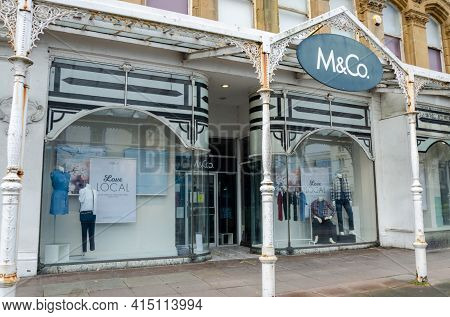 Llandudno, Uk: Mar 18, 2021: M&co Have A Store On Gloddaeth Street. They Are A Chain Retailer Of Men