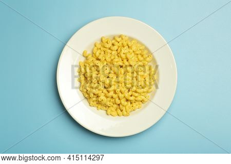 Pasta Background. Mac And Cheese Pasta On A Blue Background. American Style Italian Pasta With Chees
