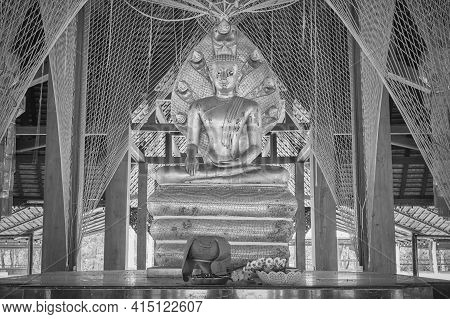 Phayao, Thailand - Dec 20, 2020: Black And White Zoom View Buddha Protected By Serpent Or Naga Statu