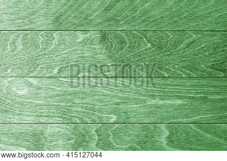 The Texture Of Light Green Natural Wooden Surface With Hardwood Boards. Hardwood Texture. Empty Back