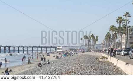 Oceanside, California Usa -16 Feb 2020: Many People Walking Strolling On Waterfront Sea Promenade, B
