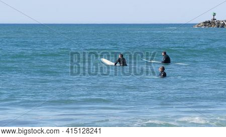 Oceanside, California Usa -26 Feb 2020: People Surfing, Surfers Swimming In Cold Water And Waiting S