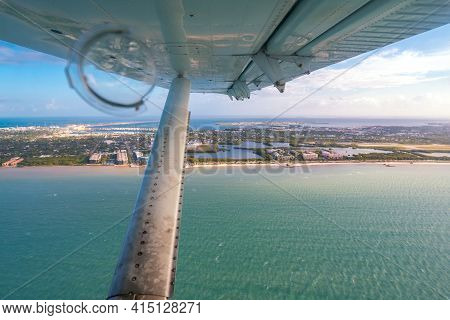 Aerial View From The Window Of A Small Hydroplane Flying Over Key West, Dry Tortugas, Florida. Wing