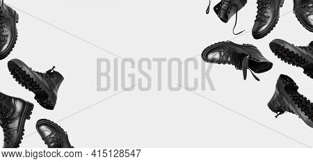 Black Flying Leather Mens Or Womens Boots Isolated On Light Gray Background. Fashionable Stylish Hik
