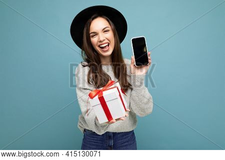 Photo Shot Of Attractive Happy Laughing Young Brunet Woman Isolated Over Blue Background Wall Wearin