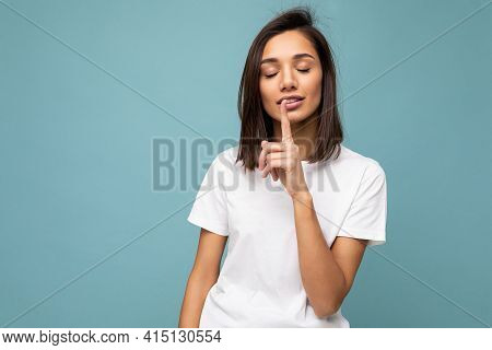 Portrait Of Positive Young Attractive Brunette Woman With Sincere Emotions Wearing Casual White T-sh