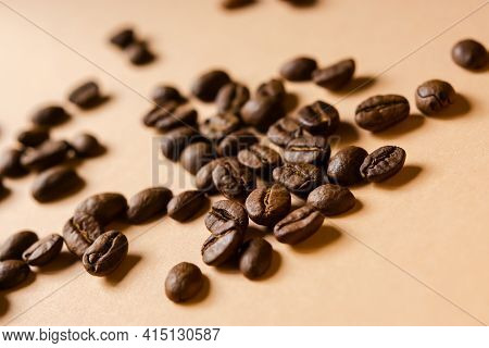 Coffee Grain Beige Background Top View. Textured Background For The Design. Brown Roasted Macro Bean