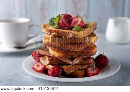 French Toast With Cinnamon, Strawberries And Mint For Coffee Or Tea. Morning Breakfast
