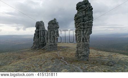 Aerial View Of Breathtaking Stone Pillars On The Top Of A Hill. Clip. High Rocks Rising Up On Cloudy