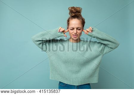 Portrait Of Young Emotional Nice Winsome Blond Woman With Sincere Emotions Wearing Trendy Blue Sweat