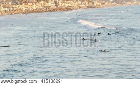 Oceanside, California Usa - 16 Feb 2020: People Surfing, Surfers Swimming In Water And Waiting Sea W