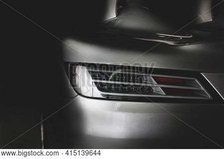 Car Headlights. Part Of The Car In The Shade. Luxury Headlights
