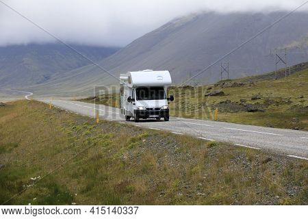 Iceland - August 29, 2017: A Camper On The Main Road In Iceland Colled The Ring Road, Iceland, Europ