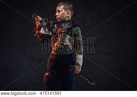 Young Survivor With Gun And Knife In Dark Background