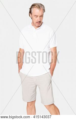Mature man in basic white polo shirt with design space