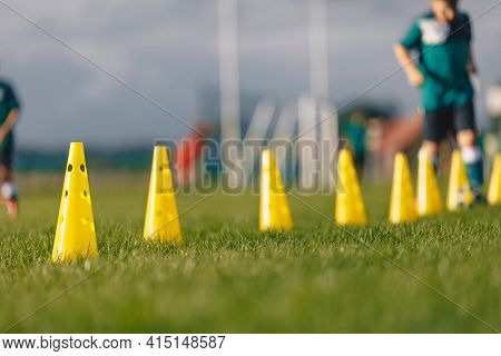 Soccer Training Camp For Kids. Boys Practice Dribbling In A Field. Players Develop Good Soccer Dribb