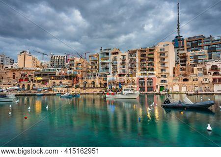 St. Julian's, Malta - January 11, 2019: Dawn over the St. Julian's town on Malta. This is very popular tourist destination on Malta.