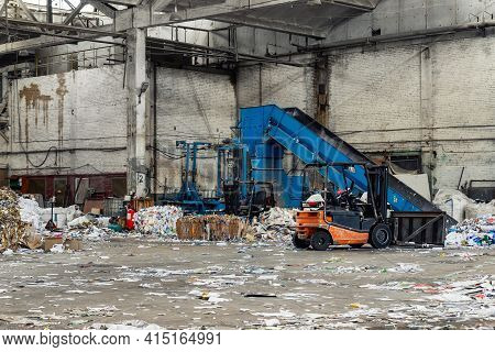 Many Forklift Machine Equipment Facility At Scrap Paper Cardboard Wrap Box Recycling Factory. Enviro