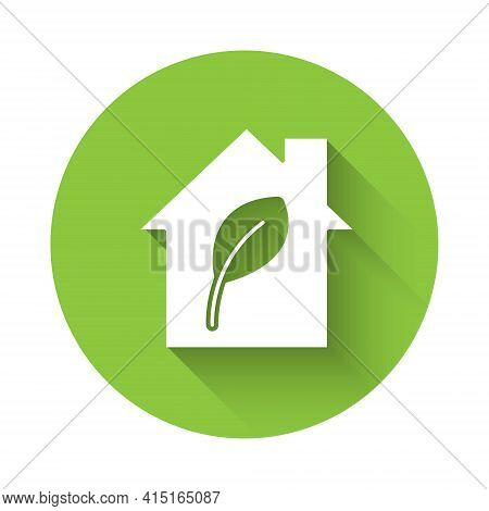 White Eco Friendly House Icon Isolated With Long Shadow. Eco House With Leaf. Green Circle Button. V