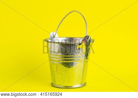 Empty Metal Bucket On A Yellow Background Close-up