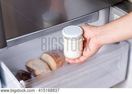 Frozen Dairy Products. Frozen Sour Cream In The Freezer. Frozen Food