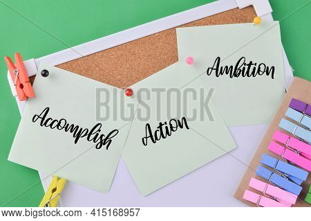 Memo Note Written With Accomplish, Action And Ambition