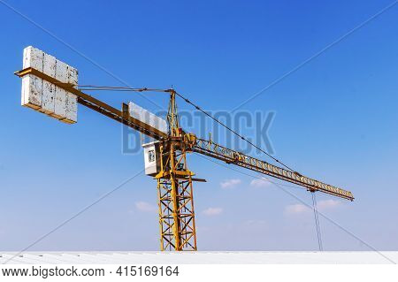 The Construction Crane With The Cloud Sky Background At The Construction Site. The Tower Crane Again