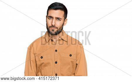 Young hispanic man wearing casual clothes skeptic and nervous, frowning upset because of problem. negative person.