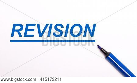 On A Light Background, An Open Blue Felt-tip Pen And The Text Revision