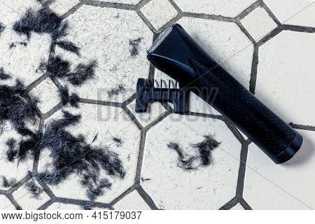 Electric Hair Clipper And Cut Hair On The Floor. Self-haircut Head And Beard